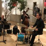 JP Morgan Jazz playing group in big hall cafe
